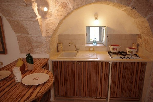Open-plan kitchen Location Unusual accommodation 85263 Martina Franca